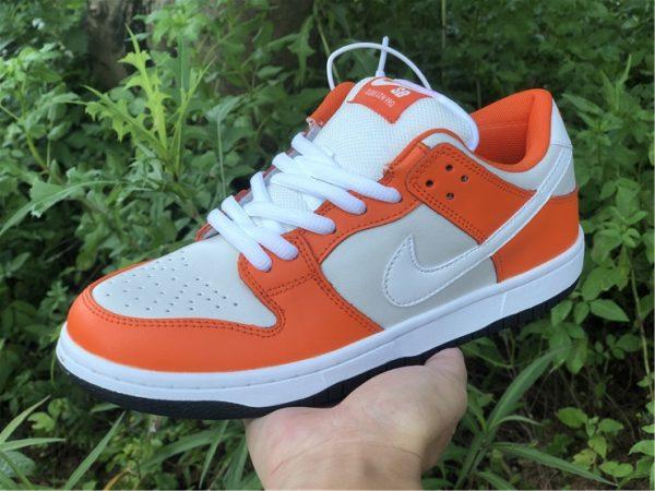 Nike SB Dunk Low Shoes White Orange Black In Hand